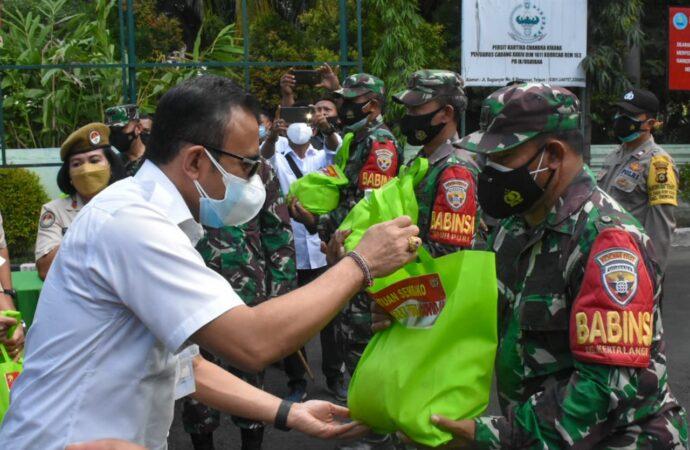 TNI/Polri Salurkan Bantuan Sembako bagi Masyarakat